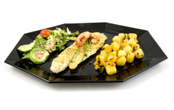 Plate with fish, potatoes and lettuce Royalty Free Stock Photography