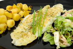 Plate with fish, potatoes and lettuce Royalty Free Stock Photo