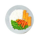 Plate with fish, rice and vegetables. Plate with fish sticks, rice, baby carrots, and green peas, on white background Stock Photos