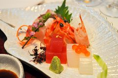 A dish of fish, squid, and shrimp sashimi stock photo