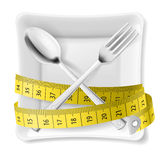 Plate with flatware and tape measure Royalty Free Stock Photography