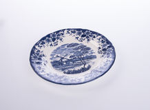 plate or flowers on plate painted by hand on background. Royalty Free Stock Photography