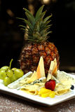 Plate of food. With cheese and fruits Stock Images