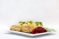 Plate with food. Potatoes meat and beet salad on the white square plate Royalty Free Stock Image
