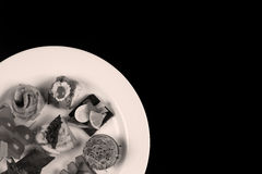Plate with food on a black background Royalty Free Stock Images