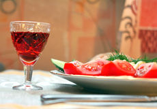 The plate of food and glass of brandy Stock Images