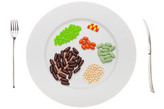 Plate with food supplements pills Stock Photos