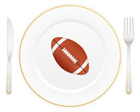 Plate and football ball Stock Image
