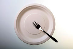 A plate with a fork Stock Photography