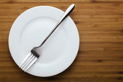 Plate and fork Stock Photography