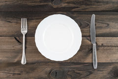 Plate with fork and butter knife stock images