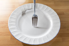 Plate and fork Royalty Free Stock Photography