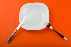 Plate with fork and knife Royalty Free Stock Photo