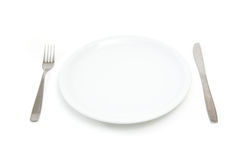 Plate with fork and knife Royalty Free Stock Image