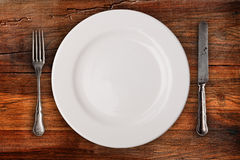 Plate, fork and knife Royalty Free Stock Photos