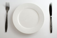 Plate, fork. knife. Knife, fork, plate white and shine royalty free stock photo