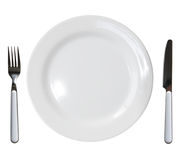 Plate fork and knife. Close up of a diner plate with fork and knife royalty free stock photo