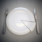 Plate, fork and knife. Empty plate with segment, fork and knife on linen background Stock Photos