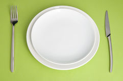 Plate, fork and  knife Royalty Free Stock Photography