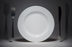 Plate and fork with knife Royalty Free Stock Images