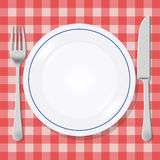 Plate fork and knife illustration. Plate fork and knife on a picnic tablecloth Stock Photo