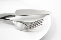 Plate with fork and knife isolated Stock Photos