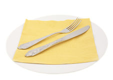 Plate and fork, knife and napking. White plate, fork, knife and yellow napking Stock Images
