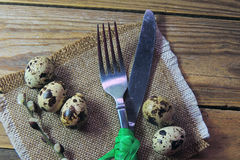 Plate, fork and knife and quail egg Stock Images