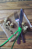 Plate, fork and knife and quail egg Stock Photo