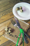 Plate, fork and knife and quail egg Royalty Free Stock Images