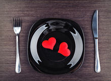 Plate, fork, knife and red heart Royalty Free Stock Image