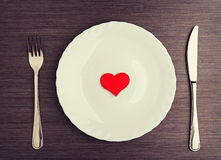 Plate, fork, knife and red heart Stock Photos