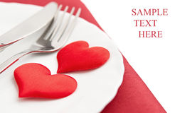 Plate, fork, knife and red hearts Stock Photos