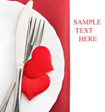Plate, fork, knife and red hearts Stock Photography