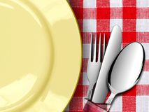 Plate with Fork and knife on Tablecloth Stock Photo