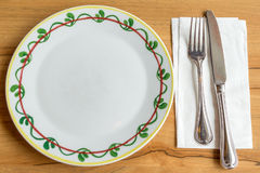 Plate with fork and knife. On wood table Stock Image