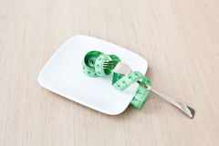 Plate with a fork and measuring tape Stock Image