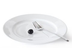 Plate, Fork And Olive. Stock Photography