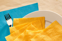 Plate, fork and serviette Royalty Free Stock Images