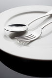 Plate with fork and spoon Stock Photo