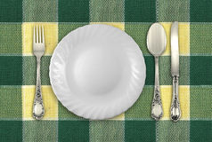Plate with fork, spoon and knife Royalty Free Stock Photos