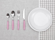 Plate with fork, spoon and knife Stock Photos
