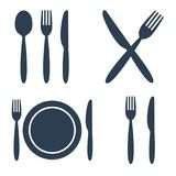 Plate, fork, spoon and knife icons set. Plate fork spoon and knife icons set on white background. Vector illustration Stock Image
