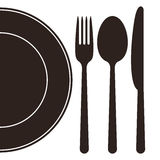 Plate, fork, spoon and knife Stock Photo