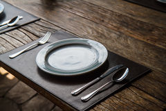 Plate fork spoon on the table Stock Photo