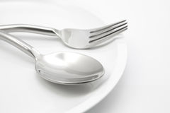 Plate with fork and spoon   Stock Image