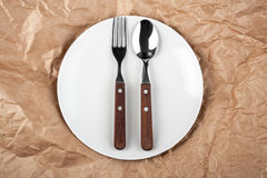 Plate with fork and spoon Royalty Free Stock Photo