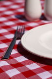 Plate and fork on table Stock Images