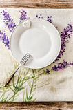 Plate and fork on vintage wooden dining table Royalty Free Stock Photography