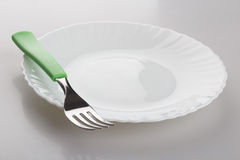 Plate and fork Stock Photo